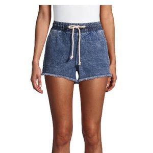 No Boundaries tie front jean cutoff shorts